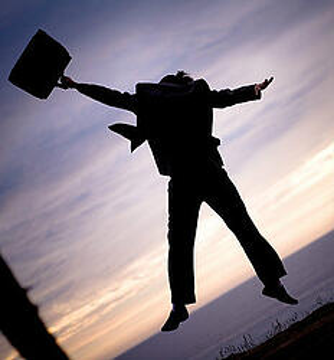man-jumping-briefcase